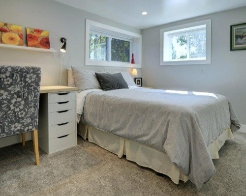 a photo of a completely renovated basement bedroom