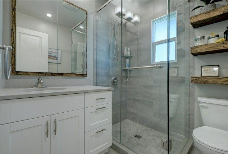 a recent bathroom renovation with new vanity and shower